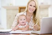 stock photo of x-files  - Couples working from home with baby - JPG