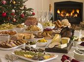 stock photo of boxing day  - Boxing Day Buffet Lunch Christmas Tree and Log Fire - JPG