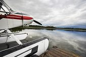 picture of float-plane  - Float plane tied up to wooden dock at lake - JPG