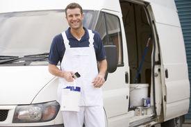 stock photo of self-employment  - Painter stood by van - JPG