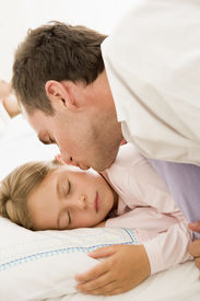 stock photo of goodnight  - Man reading son bed time story - JPG