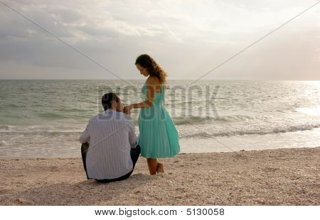 Classic Image Of Man Kissing Womans Hand At The Beach At Sunset