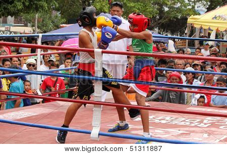 Amateur boxers exchange punches