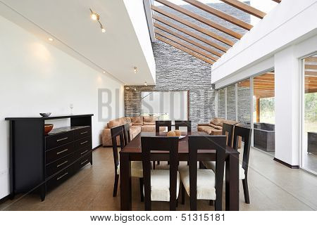 Interior design: Modern dining room and living room with big empty white wall