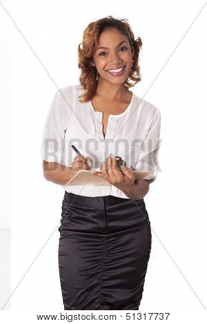 Pretty Woman With A Big Smile Holds A Clipboard.