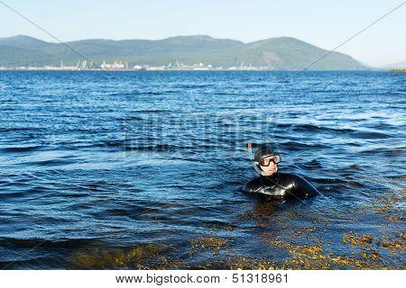 Underwater Hunter In A Wetsuit In Water