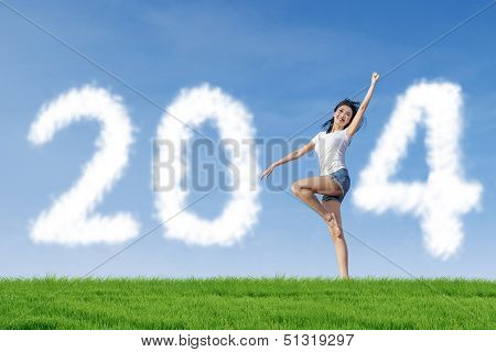 Beautiful Dancer Woman With 2014 New Year Clouds
