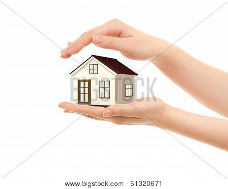 Picture Of Woman's Hands Holding A House