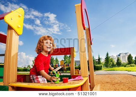 Boy In Sandbox