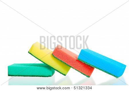 Four Multi-colored Sponges On White Background