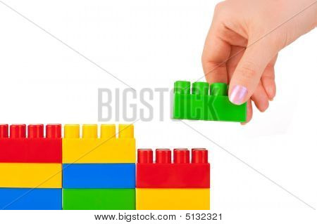 Hand And Toy Wall