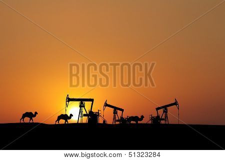 Sunset On Oil Fields With Silhouette