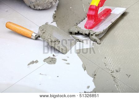 Construction Notched Trowel With Mortar For Tiles Work
