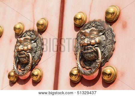 Metal Knocker On The Door In The Forbidden City In Beijing, China