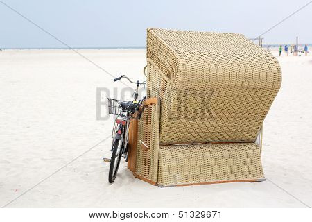 Lonely Beach Chair With Bike At The Beach Of St.peter Ording