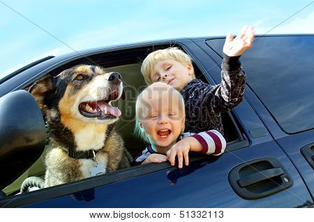Happy Children And Dog In Minivan