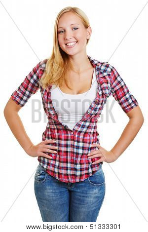 Attractive blond girl smiling with her arms akimbo