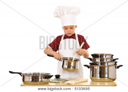 Serious Kid Chef Checking The Food