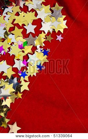 Colorful Stars On Red Velvet Background