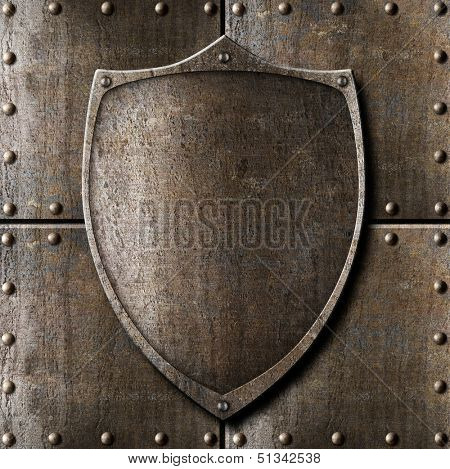 old metal shield over armour background with rivets