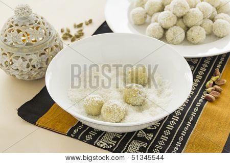 Rolling Burfi In Coconut