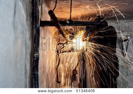 Professional Welder Cutting Metallic Pipes And Grinding Steel