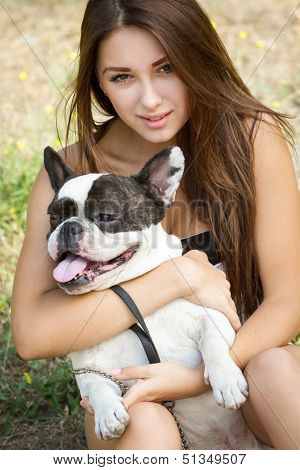 Teen Girl With Her French Bulldog Puppy