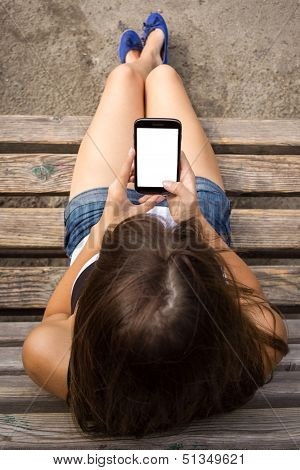 Girl Using Smartphone With Big Blank Screen