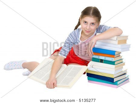 Girl Sits Having Leant The Elbows On A Books