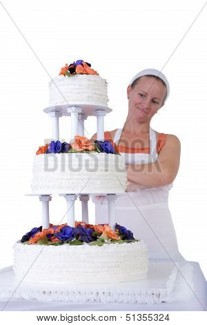 Proud Baker Lady Checking Her Ruffled Wedding Cake
