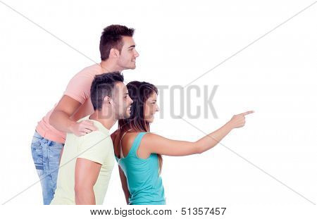 Two handsome boys with a beautiful girl indicating something isolated on a white background