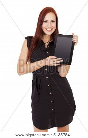 A Smiling Young Woman With Red Hair Holding Up A Tablet Computer.