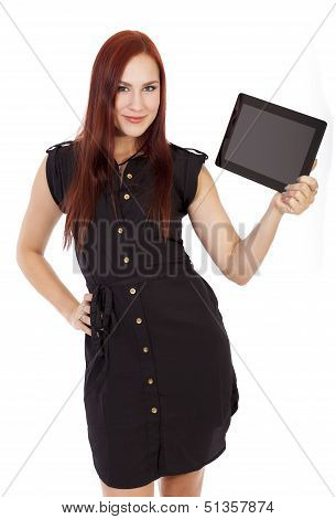 A Confident Woman With Red Hair Holds Up A Tablet Computer.