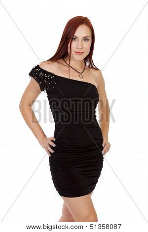 Red Hair Beauty Stands With Confidence In A Form Fitting Black Dress
