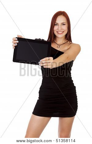 Happy Woman With Red Hair Smiles While Holding Up A Tablet Computer.