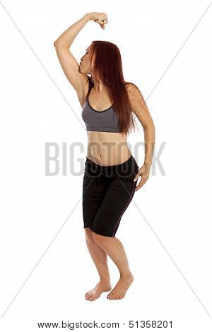Young Woman Kisses Her Arm Muscle.