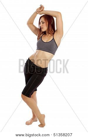 Young Woman With Six Pack Abs Poses In Workout Clothing.