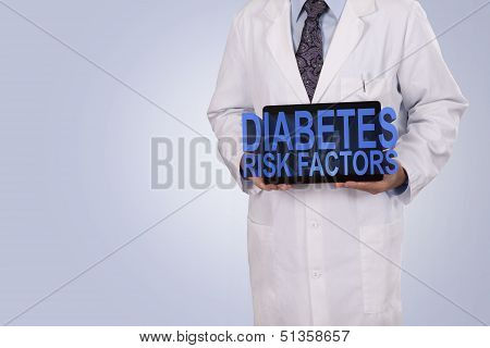 A Medical Professional Holds A Tablet Displaying The Words Diabetes Risk Factors.