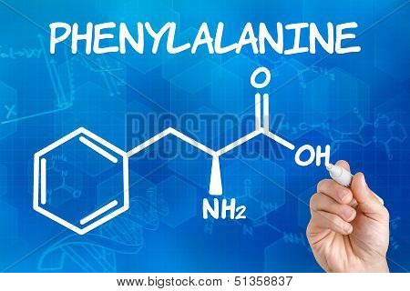 Hand with pen drawing the chemical formula of phenylalanine