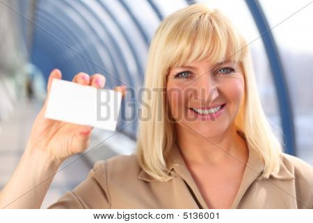 Smiling Middleaged Businesswoman Show Card