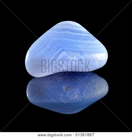 Single Blue Agate (sapphirine) stone close up  with reflection on black background