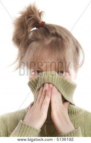 Girl Hiding Face With Hands And Sweater Collar