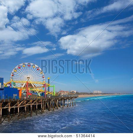 Santa Monica pier Ferris Wheel in California USA on blue Pacific Ocean