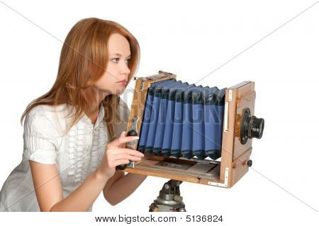 Woman Shooting Photoes With Vintage Camera