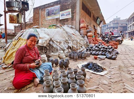 BHAKTAPUR, NEPAL - APRIL 5: Bhaktapur pottery market on April 5, 2009 in Bhaktapur, Nepal. Bhaktapur is listed as a World Heritage Site by UNESCO for its rich culture, temples and artwork.