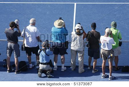 Professional photographers on tennis court during US Open 2013 trophy presentation at the Arthur Ash