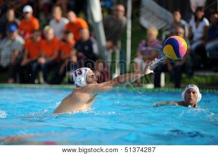 KAPOSVAR, HUNGARY - SEPTEMBER 15: Ronen Gros (13) in action at a Hungarian championship water-polo game between Kaposvar (white) and Honved (blue) on September 15, 2013 in Kaposvar, Hungary