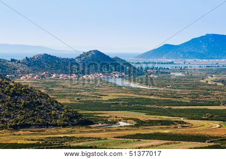 Neretva Valley With Hills And Sea In Background