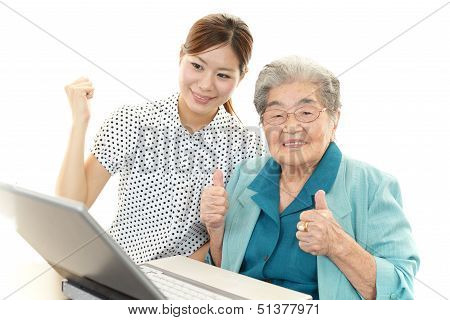 Old woman enjoys computer