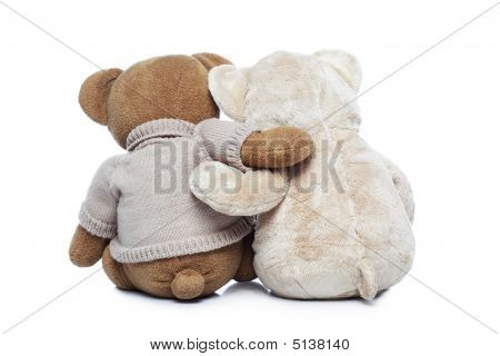Back View Of Two Teddy Bears Hugging Each Other Over White